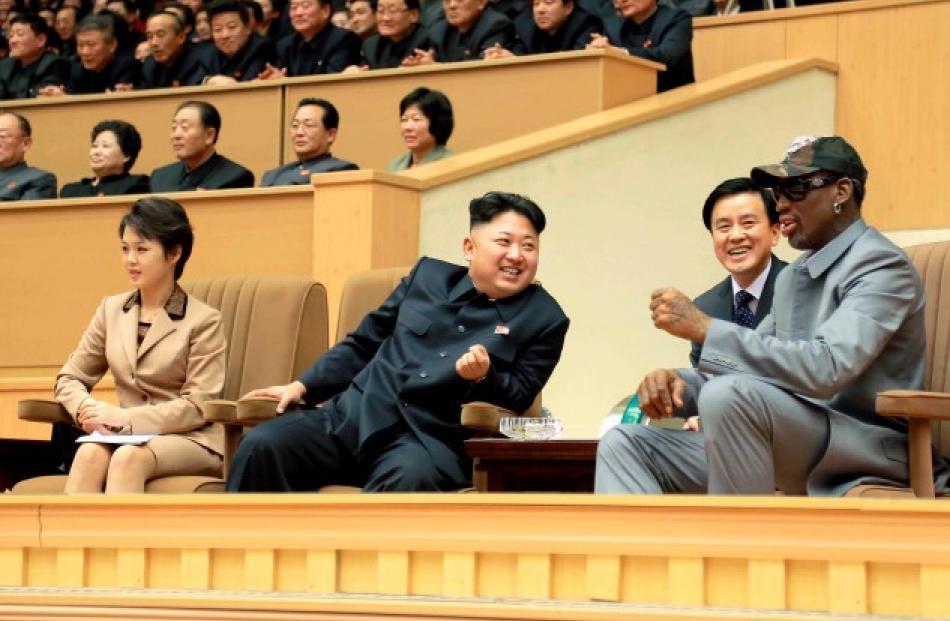 North Korean leader Kim Jong Un (2nd L) and Dennis Rodman (R) watch a basketball game between...