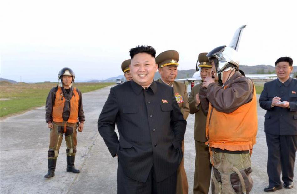 North Korean leader Kim Jong Un guides a flight training of KPA Air and Anti-Air Force Unit 188...