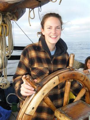 Novice sailor Leigh Harding at the helm of the Alvei sailing ship on her way to Fiji.