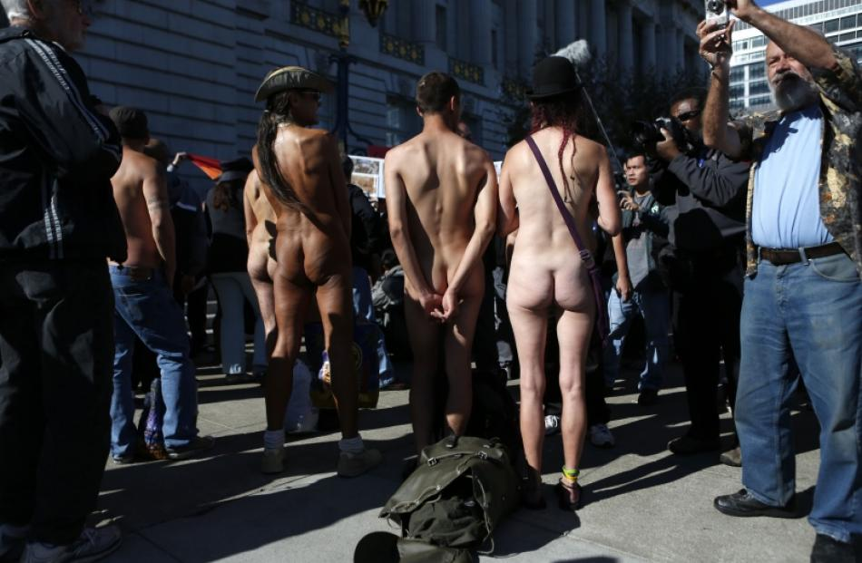 Nudists listen to speakers during a rally against the 'Wiener bill', which addresses nudity in...