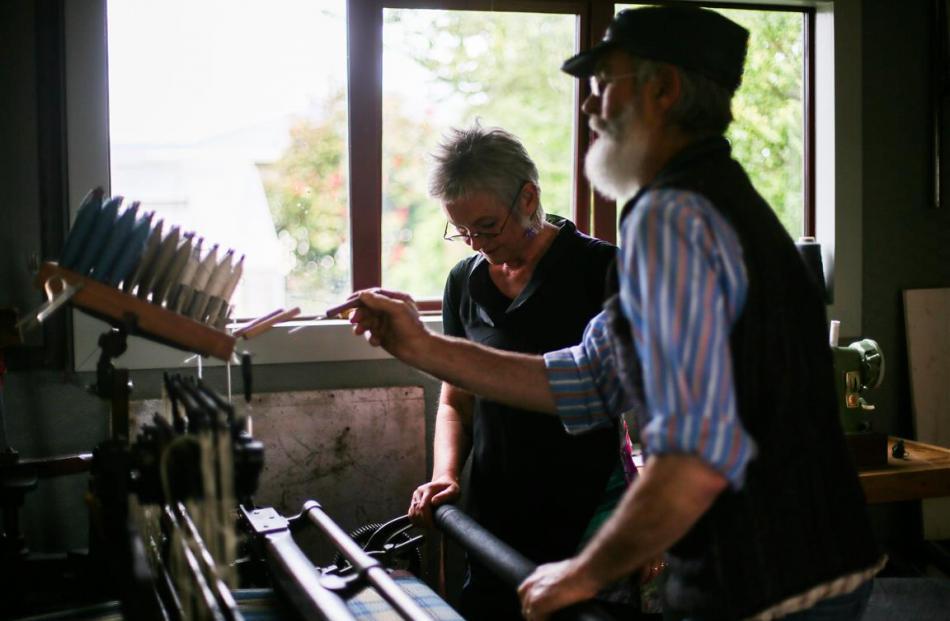 Oamaru weavers Rod and Sue McLean work on their  Hattersley loom. Photos: Rebecca Ryan