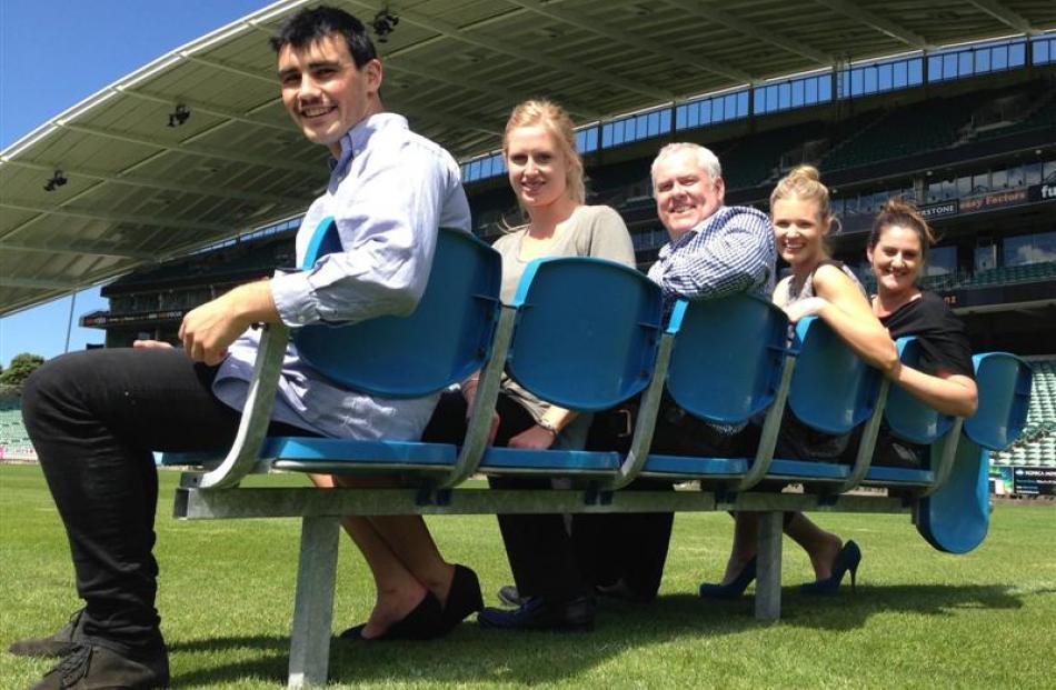On salvaged Carisbrook seats at North Harbour Stadium are (from left) stadium event co-ordinators...