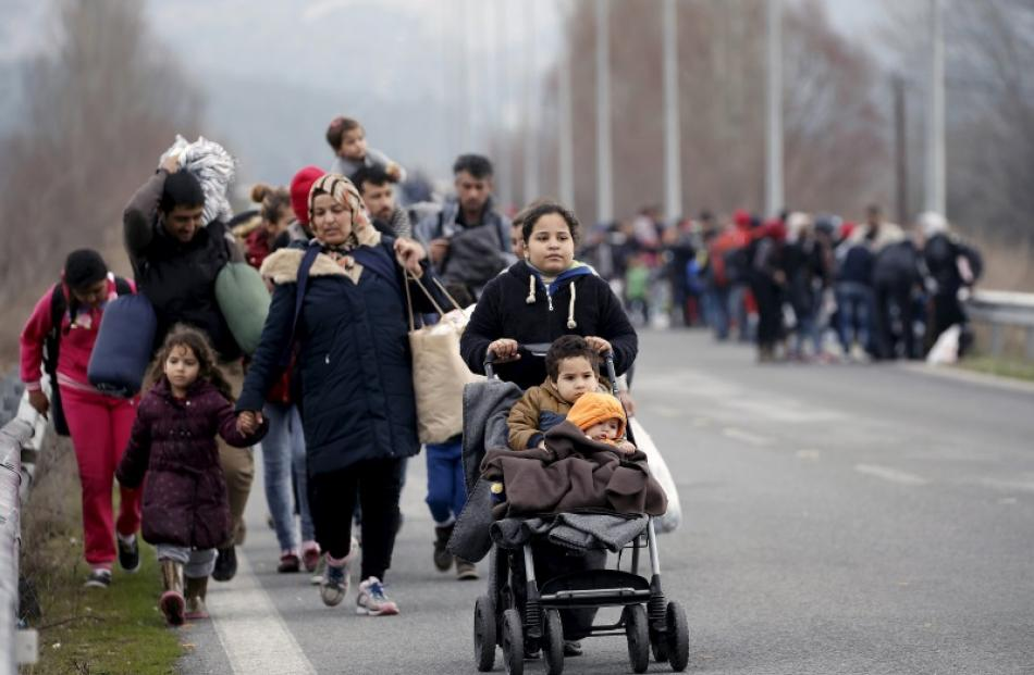 On the move ... Hundreds of mainly Iraqi and Syrian refugees walk  on a motorway towards the...