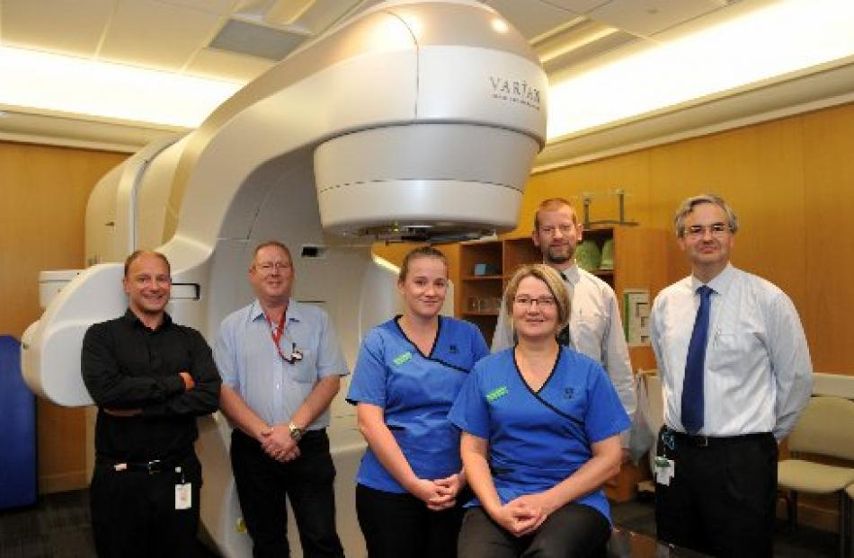 Dunedin Hospital staff (from left) medical physicist Jonathan Griffin, medical physics technician...