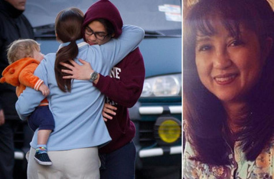 One of Blessie Gotingco's sons is comforted by a neighbour. Right, one of the last photos of...