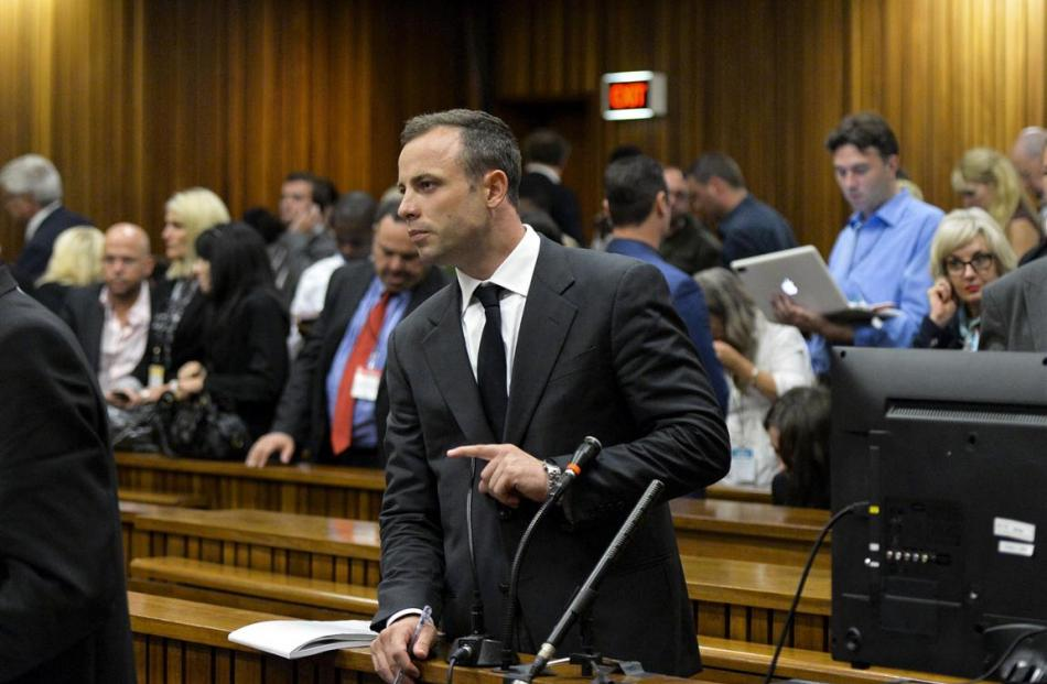 Oscar Pistorius stands in the dock during his trial for the murder of his girlfriend Reeva...