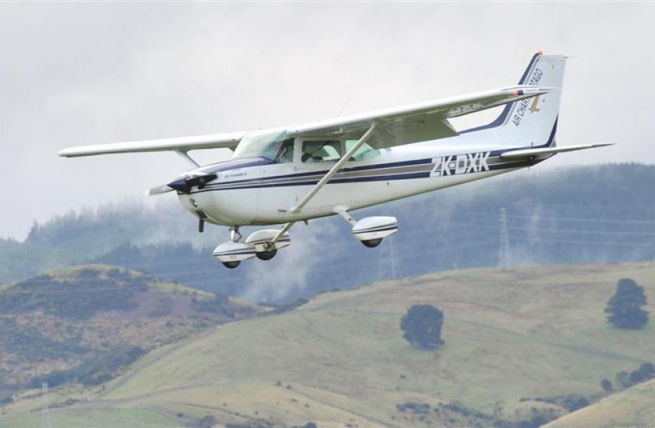 Otago Aero Club pilot Andrew Lord and Otago Boy's High School pupil Dylan Buttar-Scurr (16)...