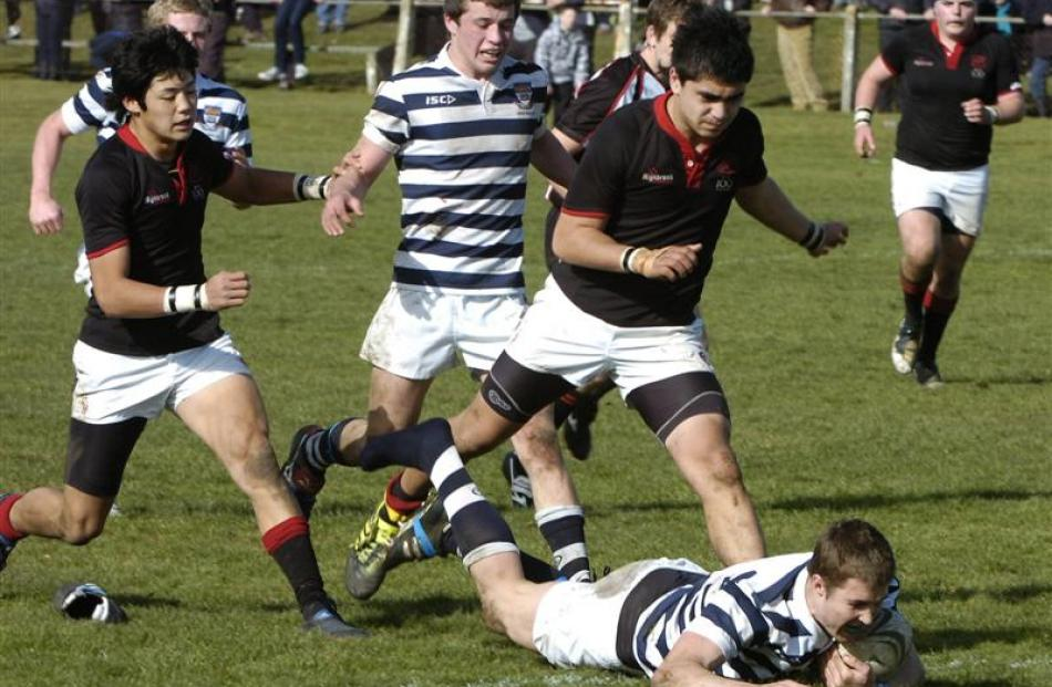 Otago Boys' captain Michael Collins scoots in for a try during the South Island First XV final at...