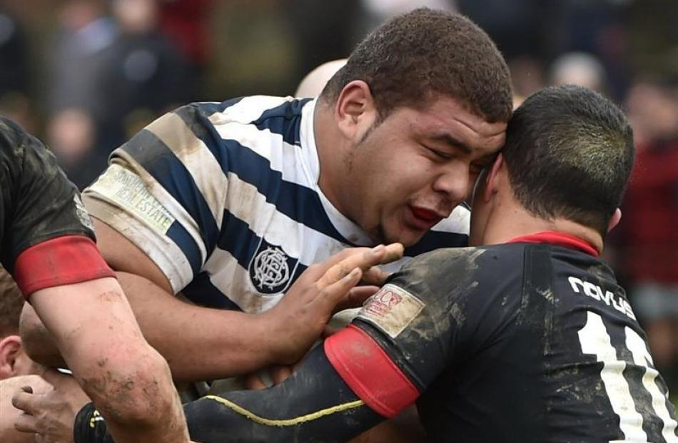 Otago Boys' High School's 135kg prop Sione Asi prevails against the a St Bede's  defender in the...