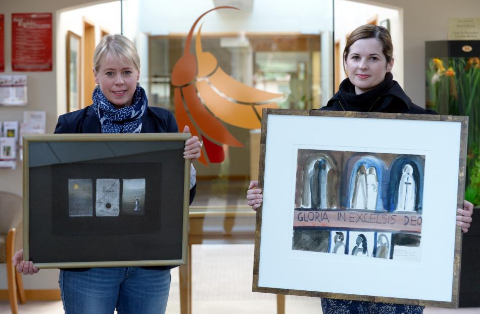 Otago Community Hospice chief executive Ginny Green (left) holds Timeshift by P. Smith and...
