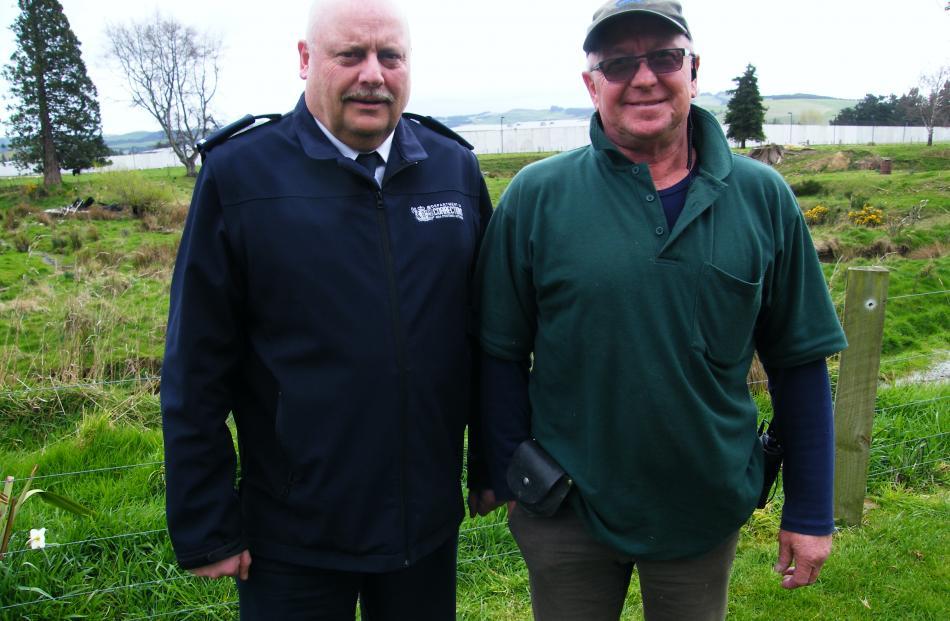 Otago Corrections Facility  manager Jack Harrison (left) and dairy farm principal instructor Tony...