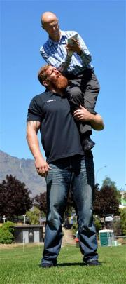 Otago Daily Times reporter Guy Williams interviews strongman Reuben de Jong. Photo by Stephen...