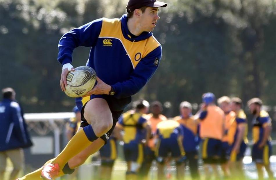 Otago first five-eighth Fletcher Smith moves the ball at Otago training at Logan Park this week....