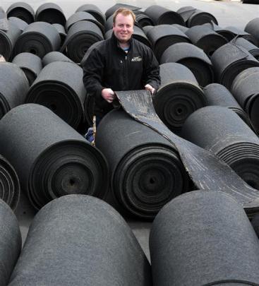 Otago Hockey Association hockey and facilities manager Sam Brown with the underlay of the...