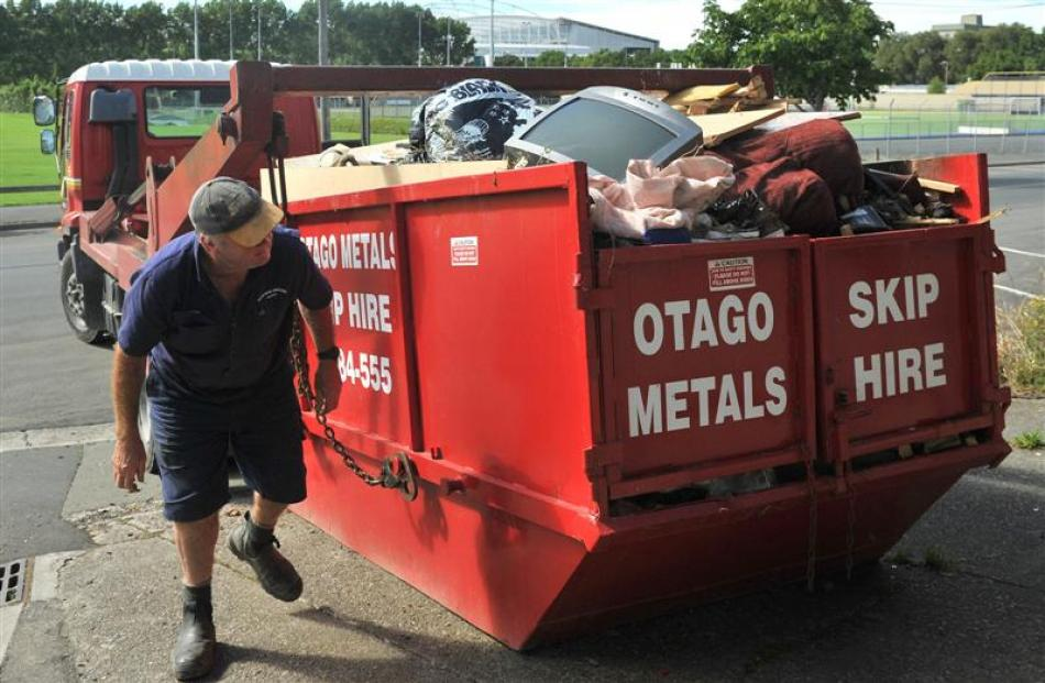 Otago Metals Skip Hire worker Allan Johnston, pictured hooking up a skip on Harbour Tce, 