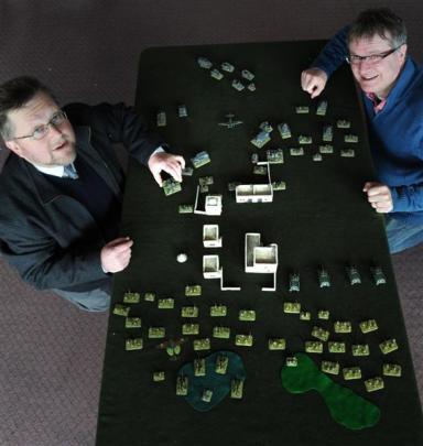 Otago Miniature Tacticians' Society member David Shead  (left) and president Bill Kearney prepare...