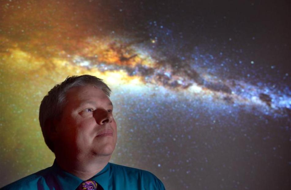 Otago Museum director Dr Ian Griffin with  a night sky image he took from the Otago Peninsula...