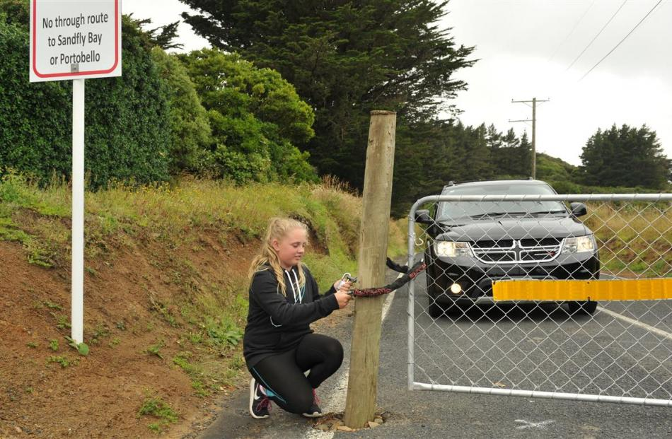 Otago Peninsula resident Sophie Potter (11) is fed up with having to open a gate blocking access...