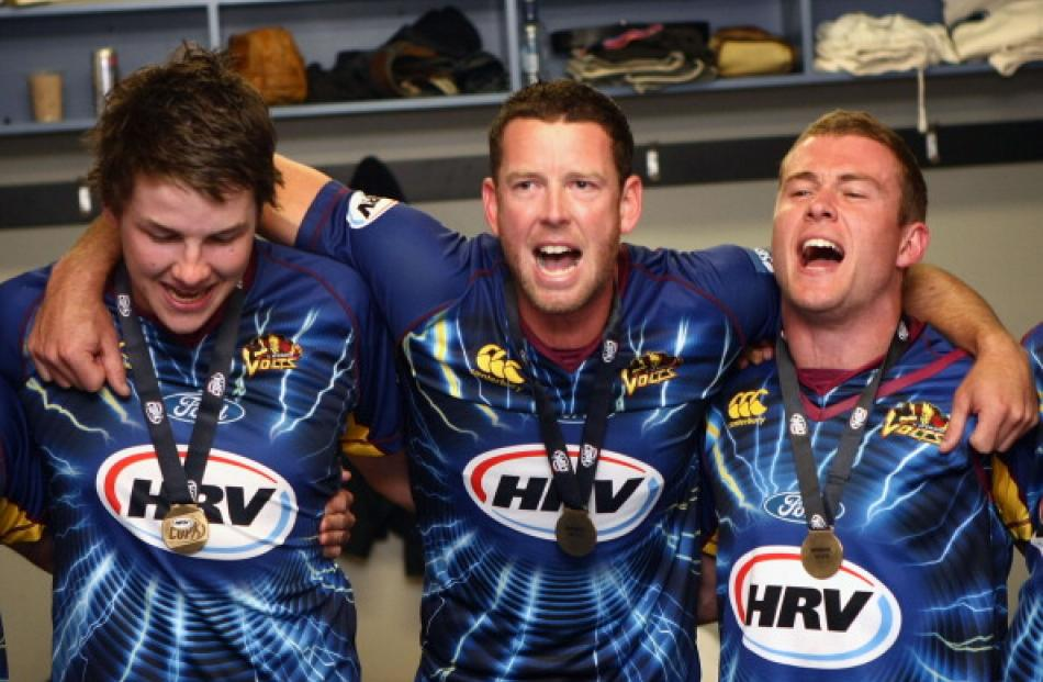 Otago players (L-R) Jacob Duffy, Ian Butler and Nick Beard celebrate after winning the HRV T20...