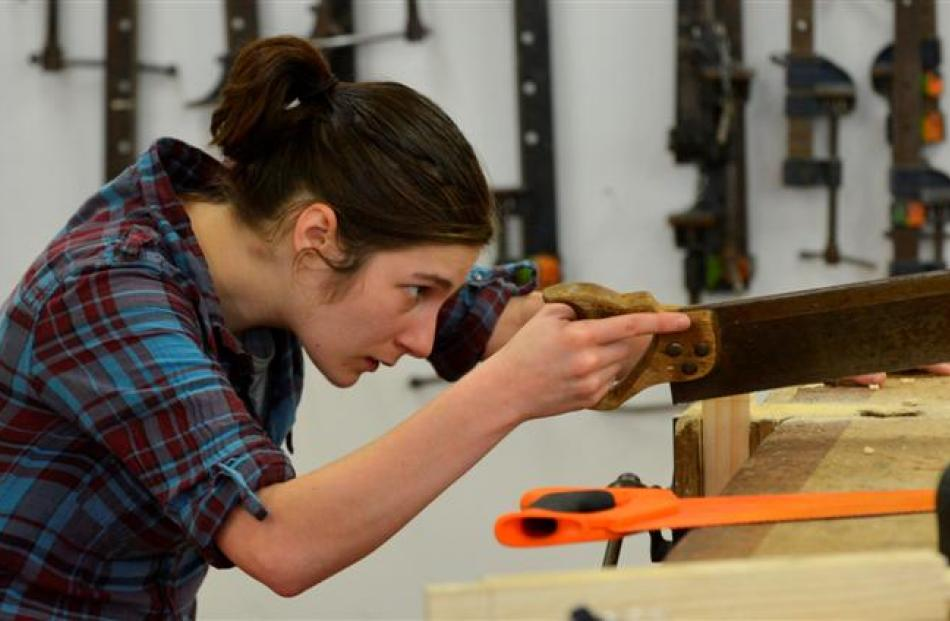Otago Polytechnic student Hope Robertson (24) works with a saw as part of a carpentry course...
