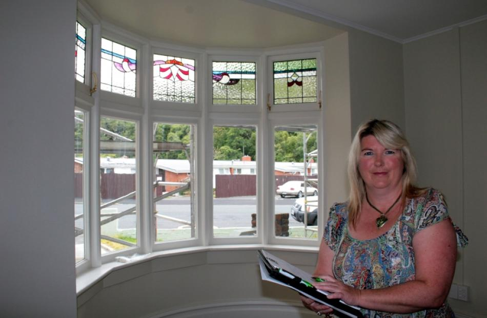 Otago Property Management managing director Sonia Thom checks on progress at a fully renovated...