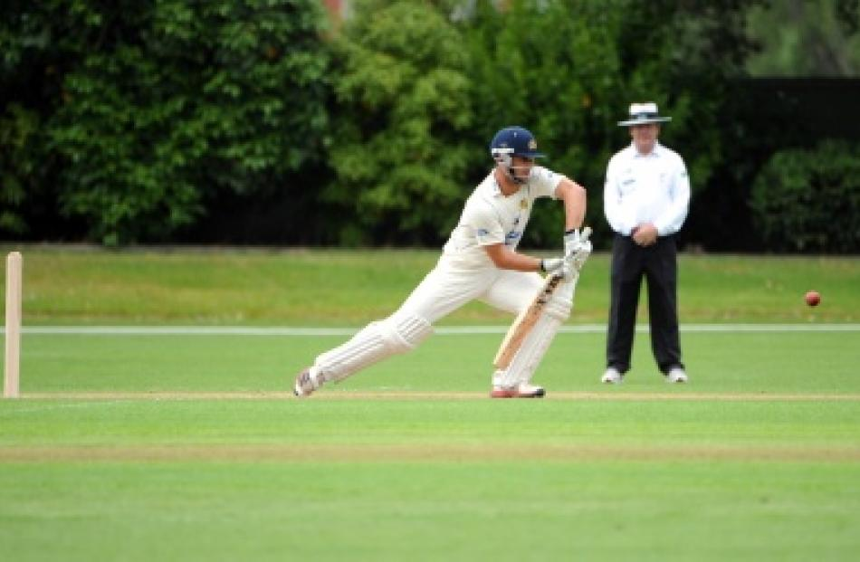 Otago's Dutch import, Ryan ten Doeschate, plays forward during his innings of 88 not out on day...