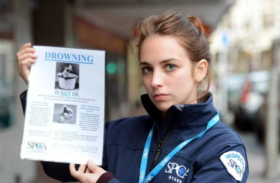 Otago SPCA inspector Rachel Stedman holds a ''Drowning is not OK'' poster, which aims to educate...