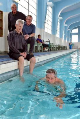 Otago Therapeutic Pool Trust trustee Fred Daniel swims, secretary-treasurer Neville Martin dips...