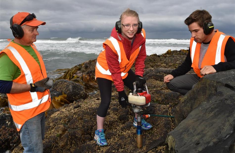 Otago University masters student Julia Moloney drills into St Clair's rocks watched by Prof Mike...