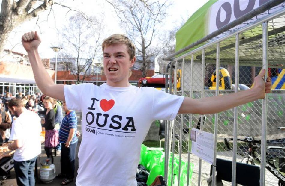 Otago University Students' Association president Logan Edgar leaves a cage on the University...