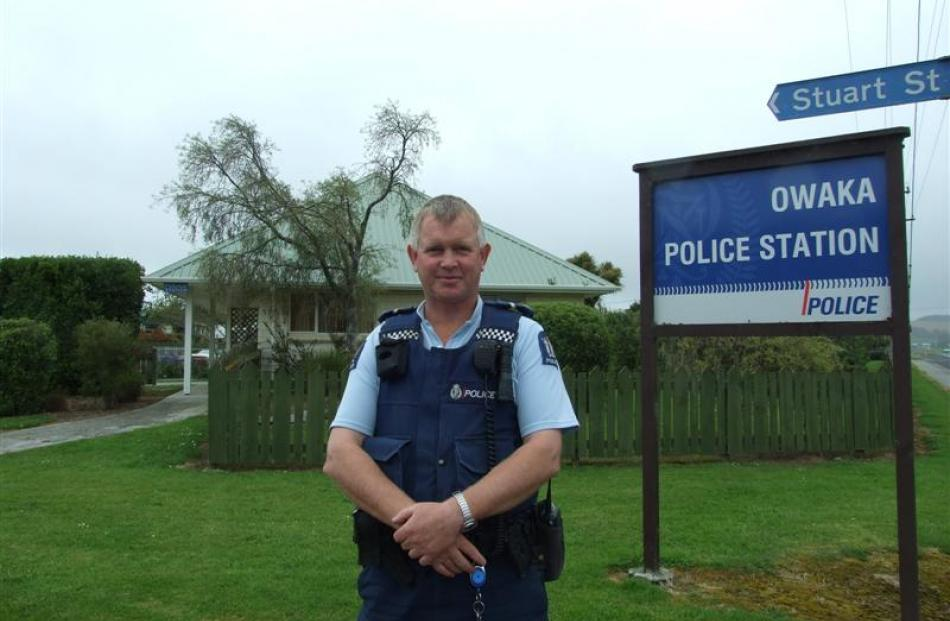 Owaka sole-charge officer Senior Constable Murray Hewitson outside his station. Photo by Helena...