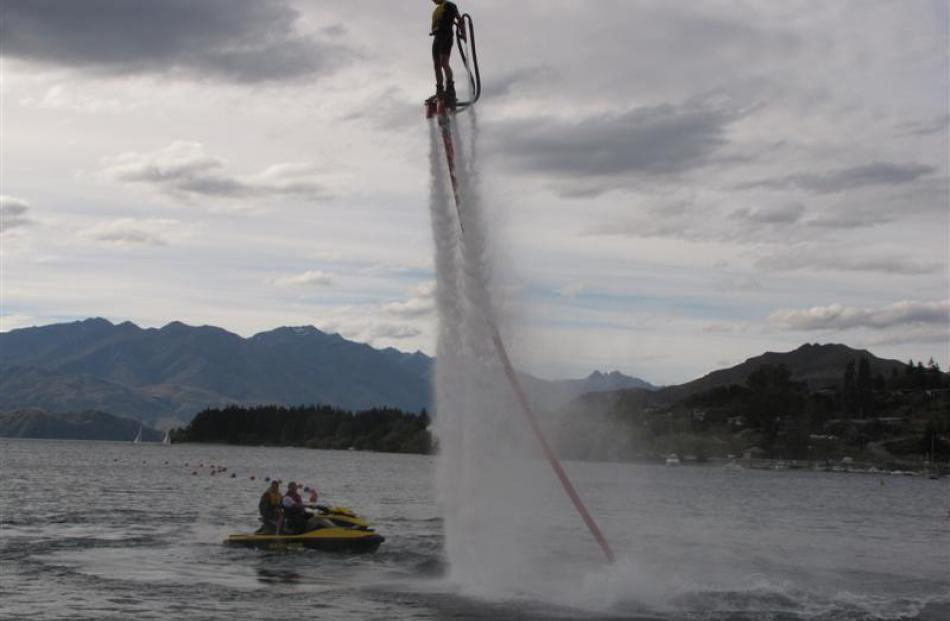 Letitia Varley gets some practice on his Flyboard on Lake Wanaka this week. Photo by Lucy Ibbotson.