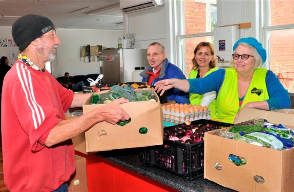 Pact members (from left) Ross Chirnside and Graeme Russell help FoodShare CEO Deborah Manning and...