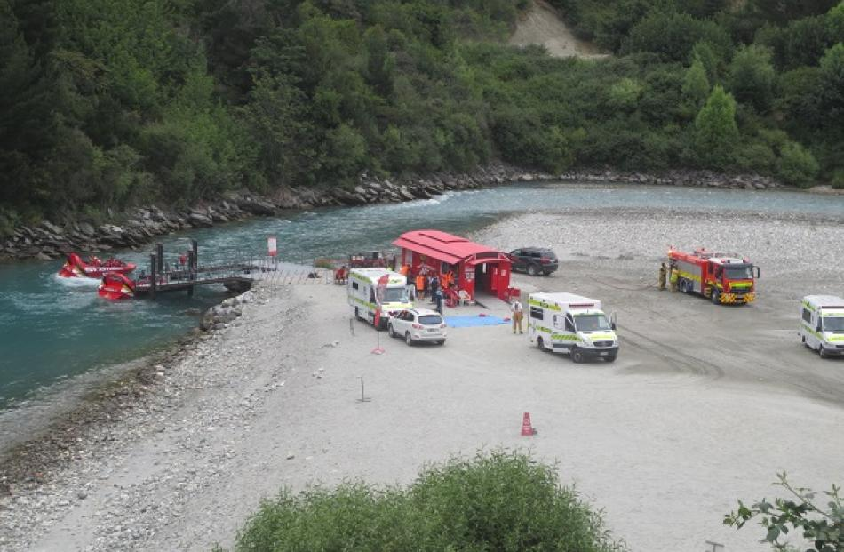 Paramedics at the Shotover Jet base after the accident yesterday. Photo Paul Taylor
