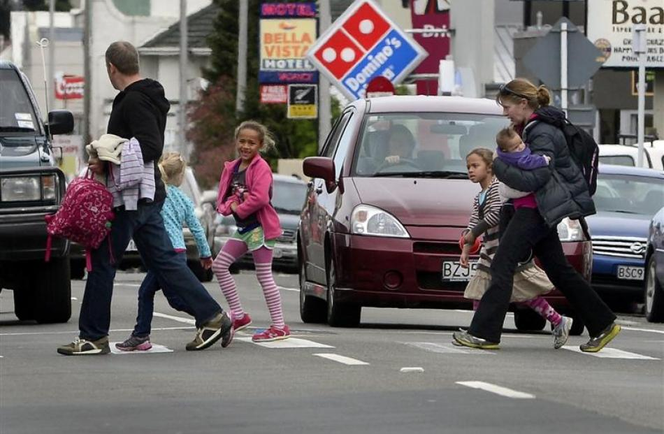 Parents picking up their children after school use a Great King St pedestrian crossing which will...