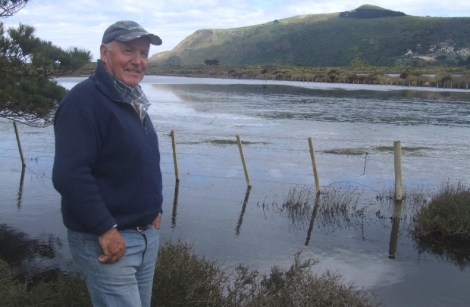 Part of Hoopers Inlet resident Sam Neill's property has been flooded because of the inlet...
