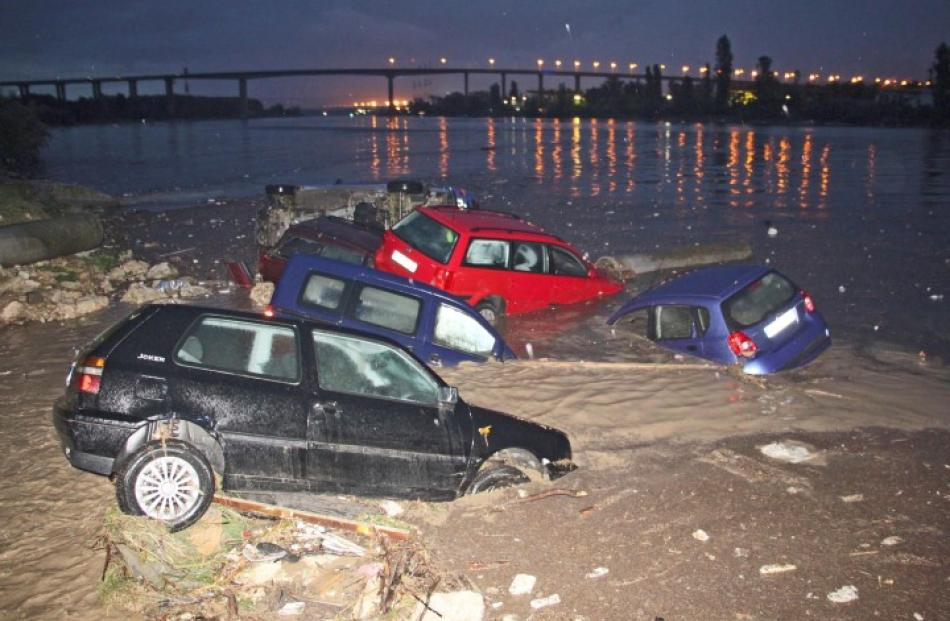 Partially-submerged cars are pictured during heavy flooding in the city of Varna, in northeastern...