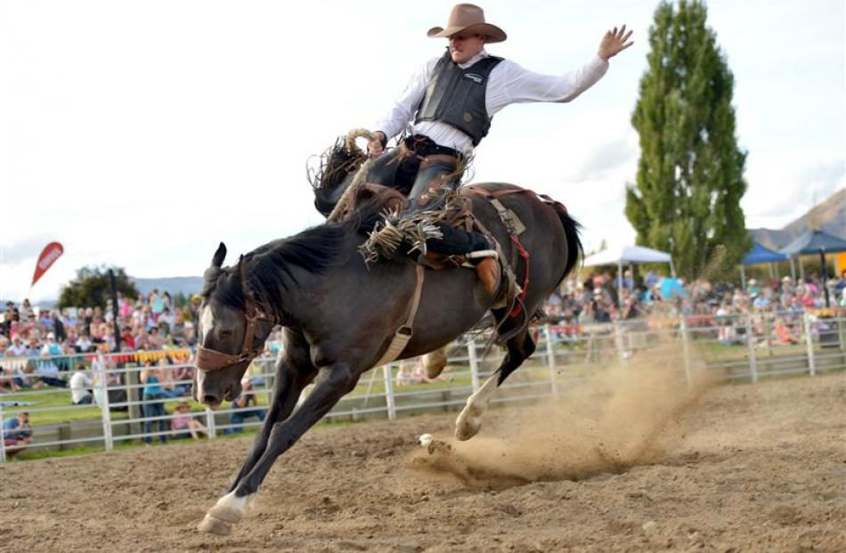 Paul Robinson, of Palmerston, contests the saddle bronc competition. Photo by Stephen Jaquiery.