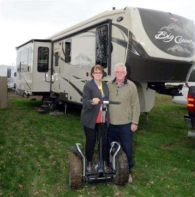 Pauline and Les Johnson with one of their  Segways outside their Big Country fifth-wheeler...