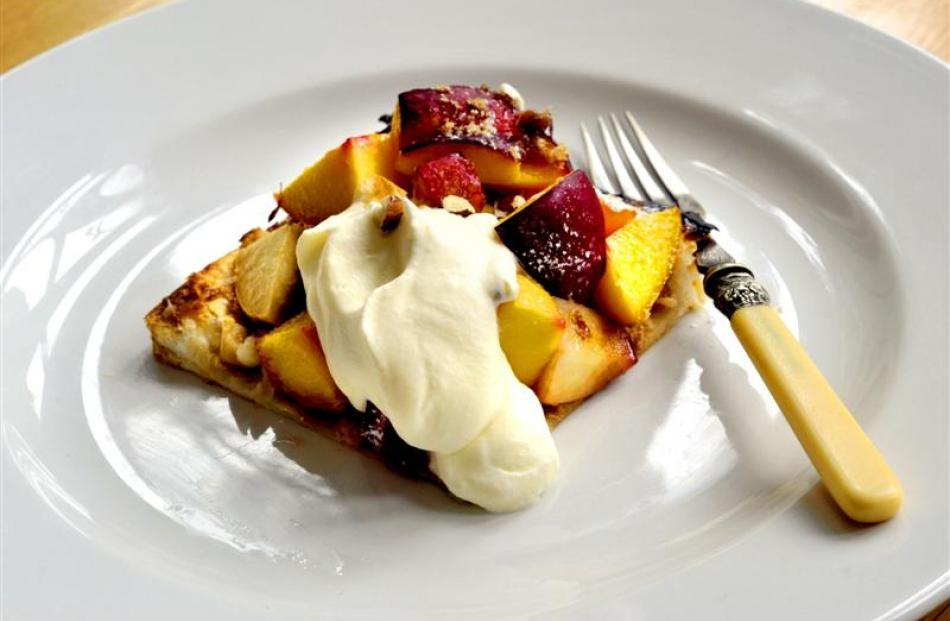 Peach tart with toasted hazelnuts and cream Photo by Gregor Richardson.