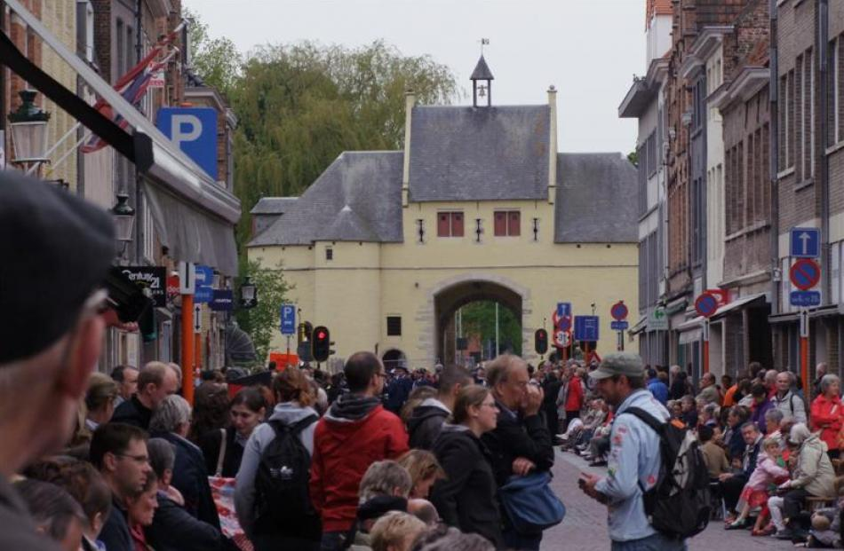 People find their places near Smedenpoort, one of Bruges' old city gates, where the procession...