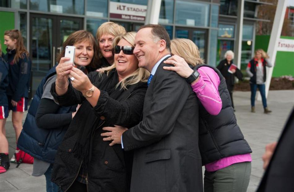 People swarmed for a selfie with Prime Minister John Key when he arrived at ILT Stadium Southland...
