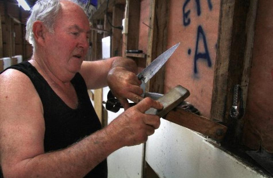 Peter Casserly sharpens his shears.