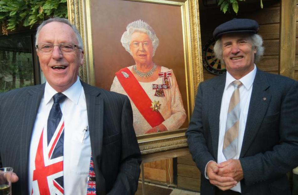 Peter Doyle (left) and Thomas Brown with a portrait of the Queen, painted by  Brown in honour of...