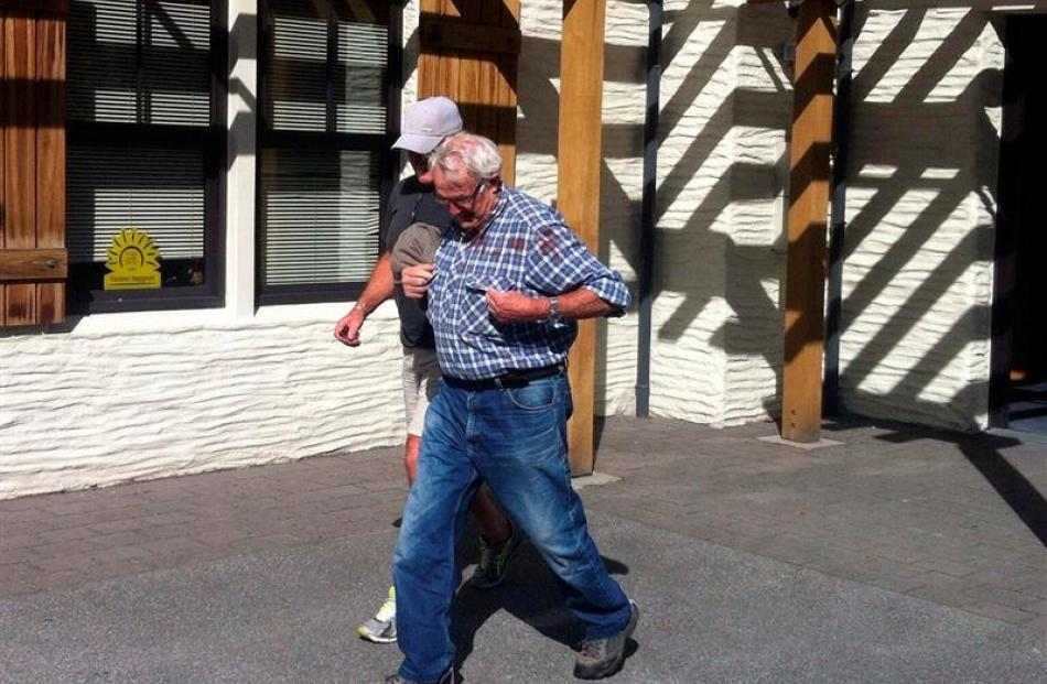 Peter John Barratt (front) leaves the Queenstown District Court after appearing yesterday. Photo...
