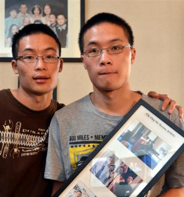 Peter Lim (right) and his twin brother Andrew speak out after Peter was subjected to racial abuse...
