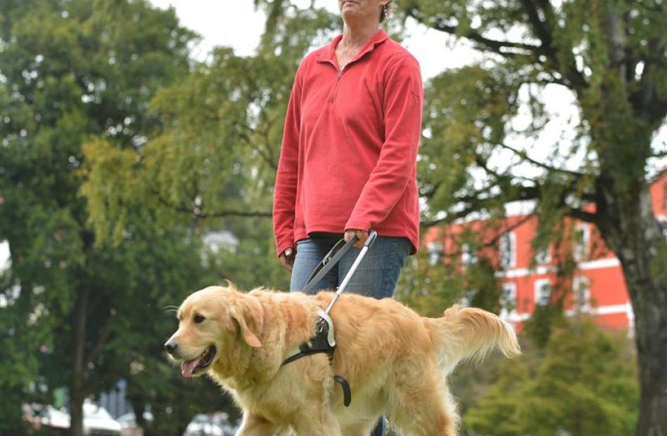 Petronella Spicer and her guide dog Fletcher, in Dunedin yesterday. The pair  are prepared for...