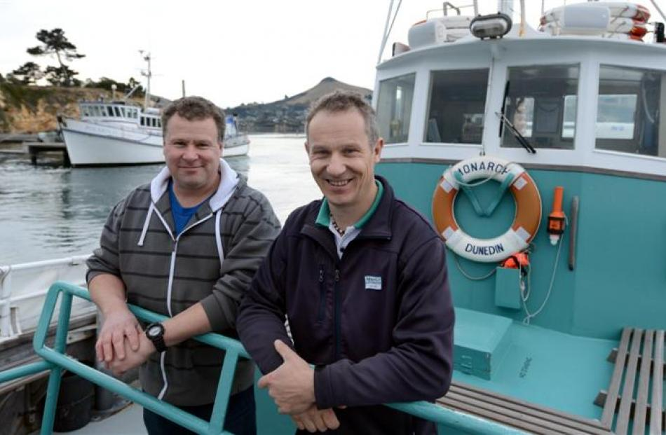 Phil (left) and Sean Heseltine both work on the ocean, Phil offshore on  Polaris II and Sean...
