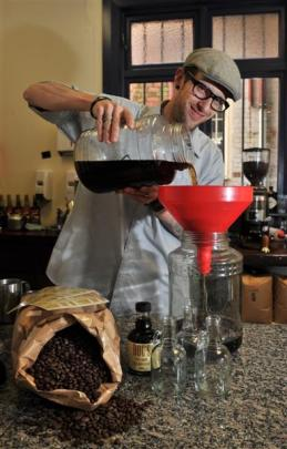 Phil McDonald makes cold-brew coffee at Doc's Coffee House. Photo by Jane Dawber.