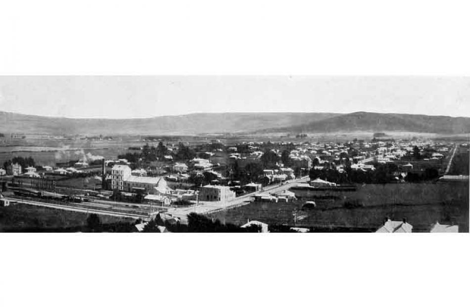 "Photo from the 'Otago Witness', the original caption reads ""Panorama of Mosgiel, the centre..."